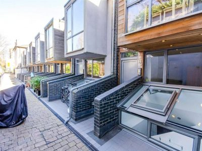 Mews House with four bedrooms, two bathrooms, side walled garden, a terrace in a gated development in Islington, N4